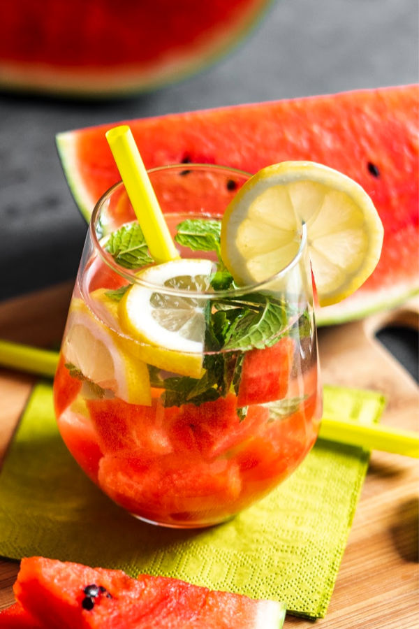 Watermelon lemonade mint in a glass with lemon pieces and fresh mint leaves
